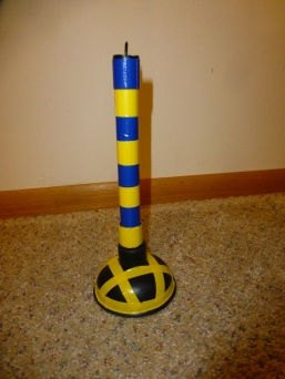Mini toilet plunger turned into a peg ring or a post to wrap around in circles.