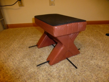 I added outriggers and a rubber top to this toddler bench so Dash can push it across the floor and then jump on it without tipping it over.