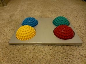 Wooden non-slip holder for FITpaws Paw Pods. These can be used for a variety of balance tricks.