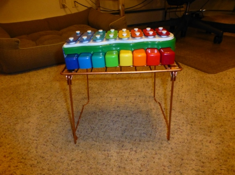 """I added a platform to our existing """"piano"""" to see if this will help Dash hit the keys better instead of aiming for the metal bars on the top."""