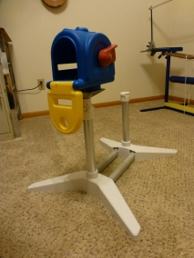 Our mailbox, now on a pole that fits on the adjustable stand.