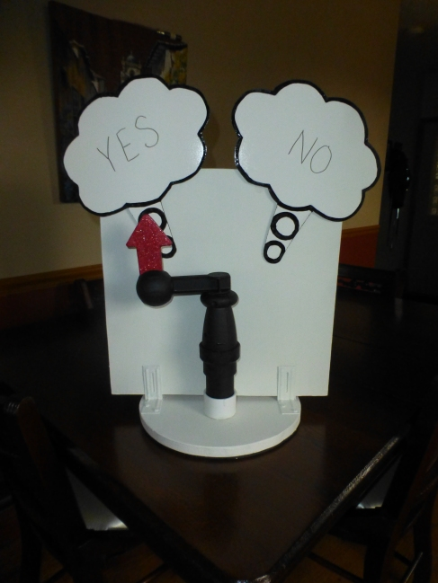 """""""Communication station""""--the dog can push the arrow in either direction to answer questions. The answers are written on a cut and painted dry erase board."""